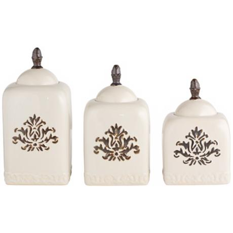 Set of 3 White Ceramic Canisters With Floral Detailing