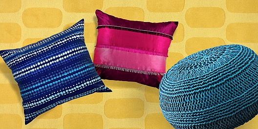 Colorful pillows and a pouf ottoman