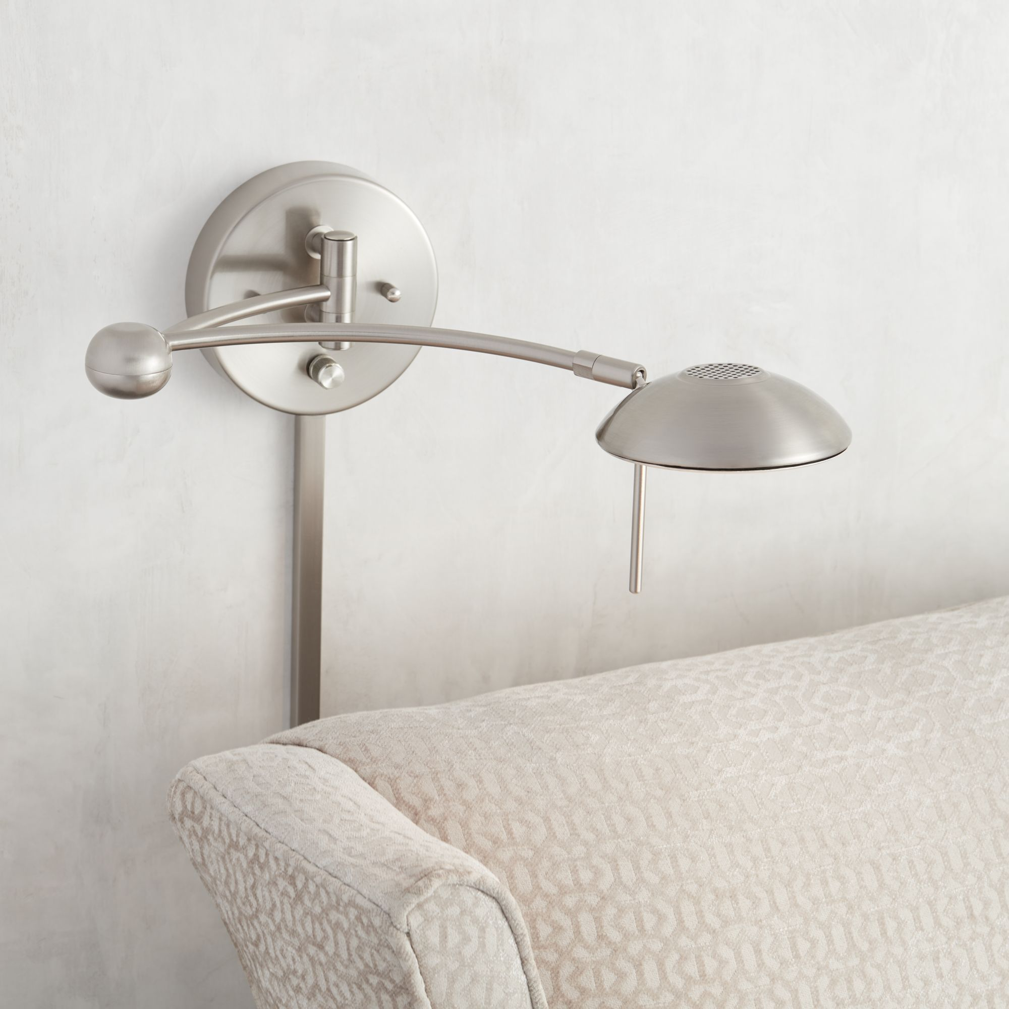 brushed steel halogen plugin swing arm wall lamp
