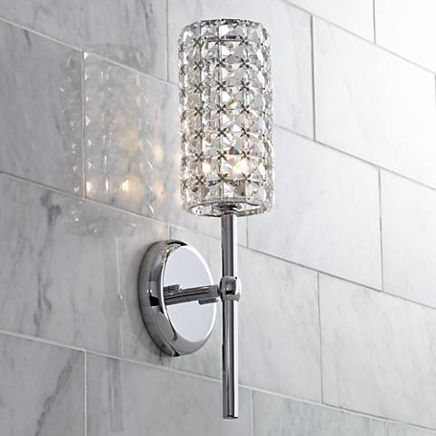 bathroom walls and line your mirrors with this glitzy crystal sconce. Black Bedroom Furniture Sets. Home Design Ideas
