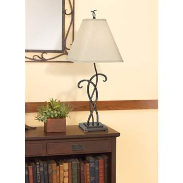 Accent a rustic hallway design with a graceful wrought iron table lamp.