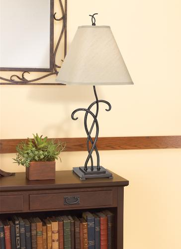 Wrought iron table lamp in rustic hallway design.