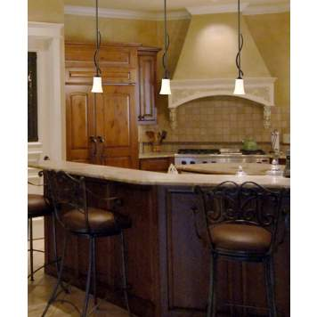 Art glass pendant lights add warmth to a kitchen island.