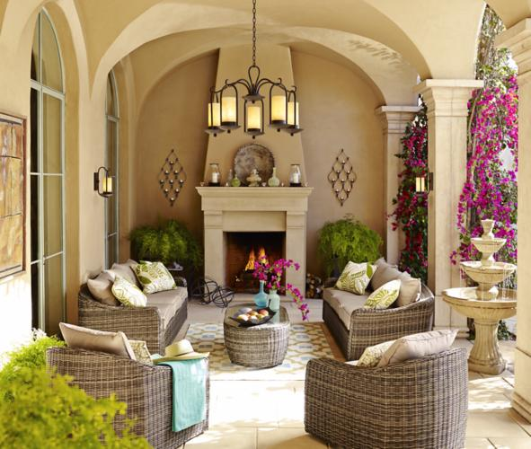 outdoor living space, chandelier, outdoor sofa, wall art, fountain