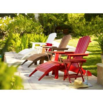 Classic slant wood Adirondack chairs brighten a poolside setting.