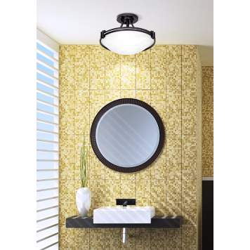 A round flushmount fixture accents this contemporary bathroom decor.