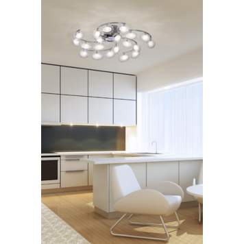 A futuristic light adds mod appeal to a contemporary kitchen picture.