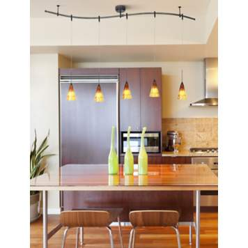 Amber art glass pendants enhance this contemporary kitchen decor.