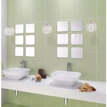 A trio of crystal pendants accents this contemporary bathroom picture.