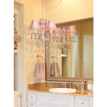 A delicate pink chandelier adds feminine charm to this bathroom picture.
