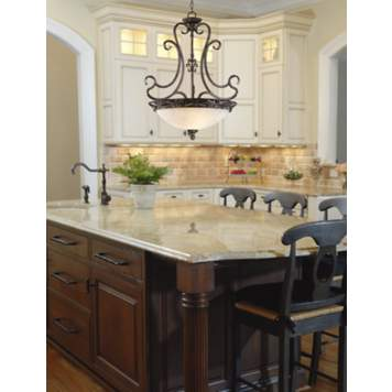 A French-style chandelier complements traditional kitchen decor.