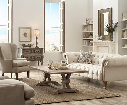 An Over Sized Tufted Sofa Is The Centerpiece Of This Comfortable Living Room