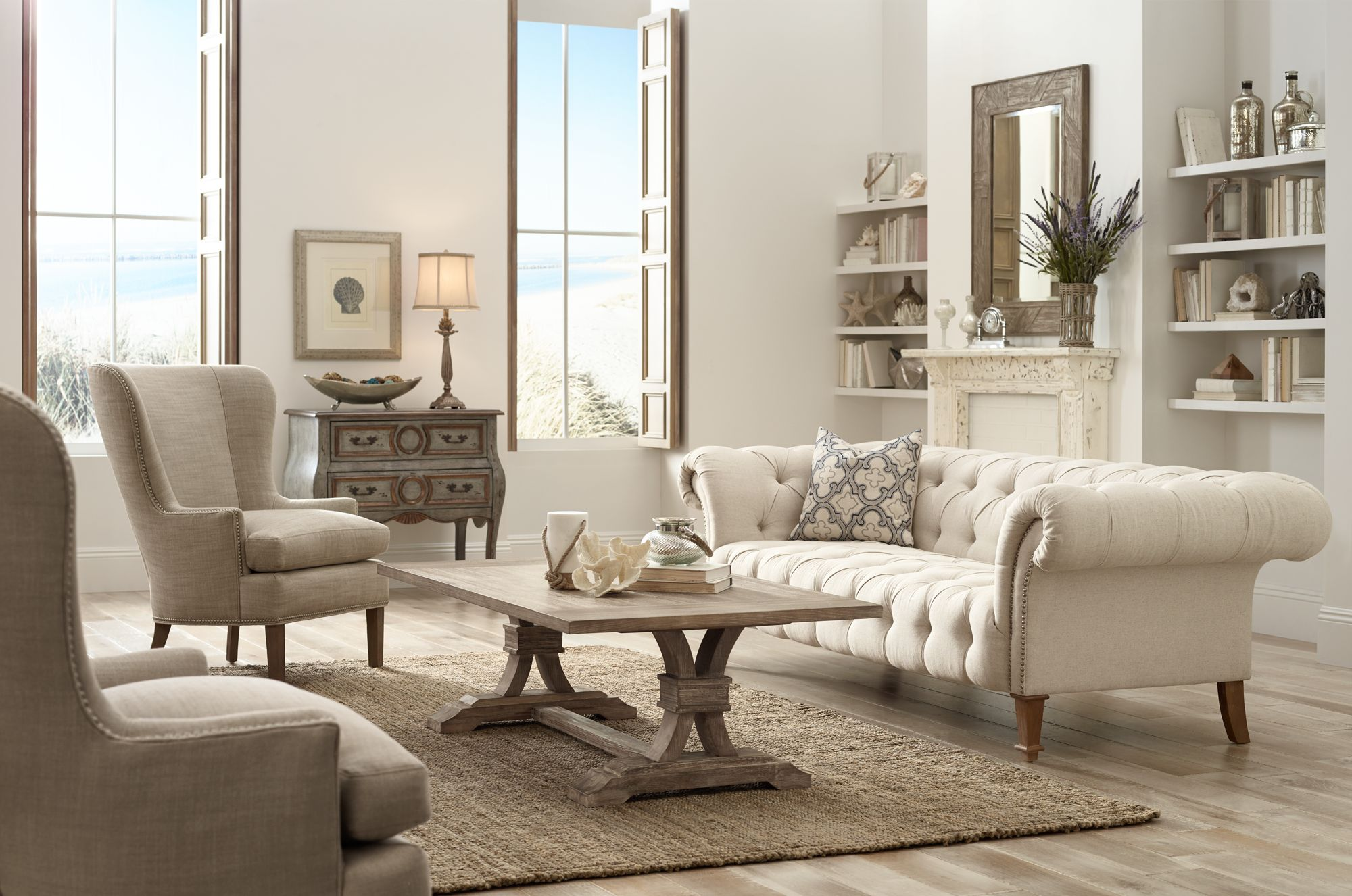 An Over Sized Tufted Sofa Is The Centerpiece Of This Comfortable Living Room .