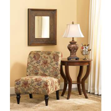 The floral print on the slipper chair creates a traditional aesthetic.