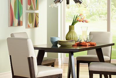This sleek dining room features a Sputnik-style chandelier overhead.