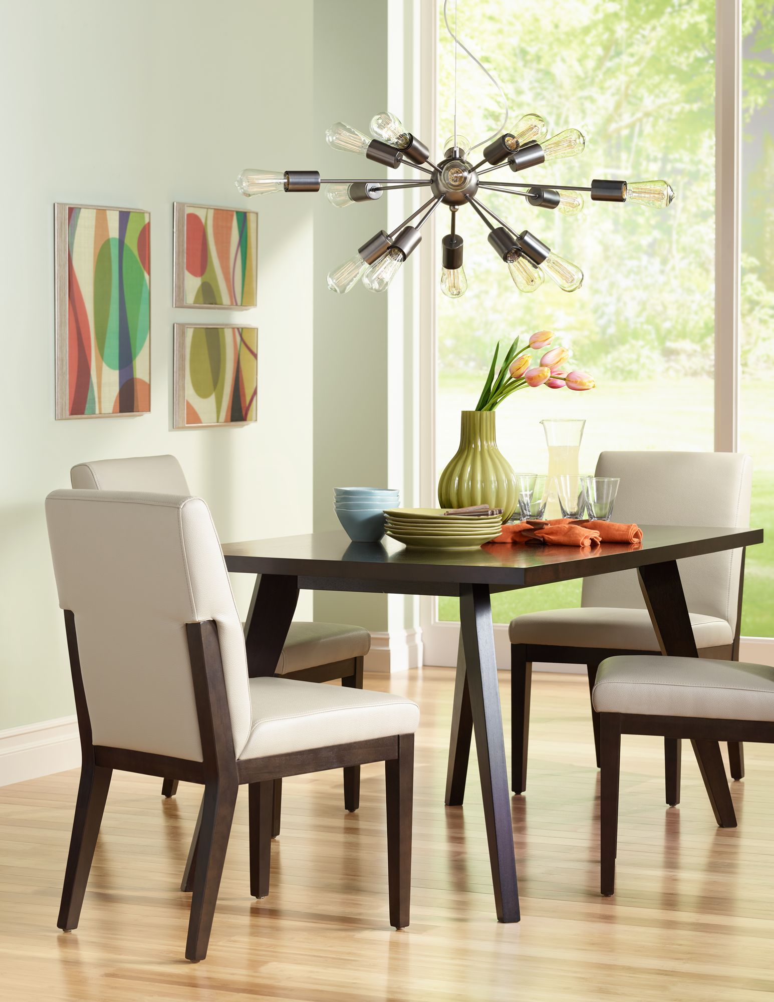 This Sleek Dining Room Features A Sputnik Style Chandelier Overhead.
