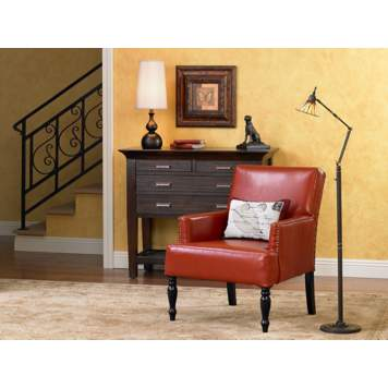 The red side chair is the focal point in the living room scene.