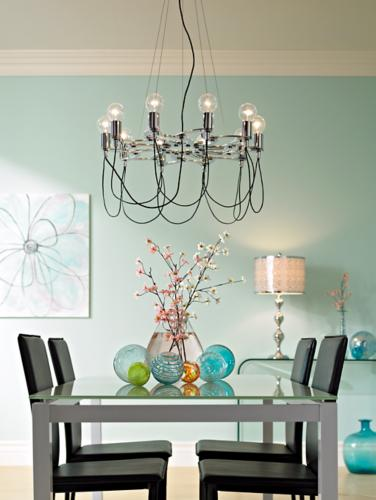 A modern glass chandelier over a dining room table