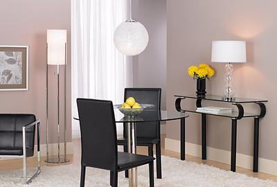 The round contemporary glass table provides a great setting for casual dining.