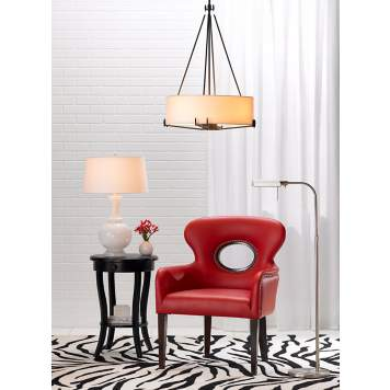 Revisit the retro era with the Odeon red faux leather with nails accent chair.