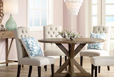 A round table and glass lighting creates an eye-catching dining room.