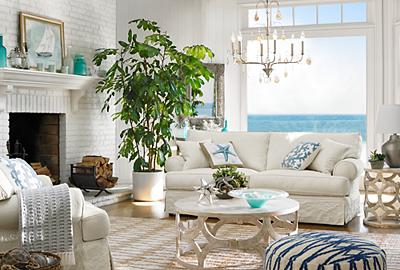 A cool and collected oceanside living room full of calming light.