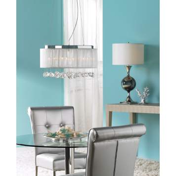 The coastal chic dining room incorporates unexpected dining chairs.