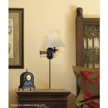 Maximize bedside table space by using a swing arm wall lamp.