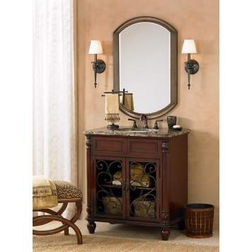 The cherry bathroom vanity with iron scrollwork creates a sophisticated space.