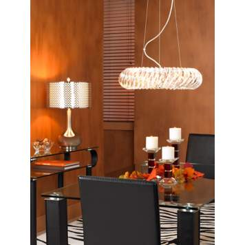 The dining room's glass and chrome finishes are balanced with amber hues.