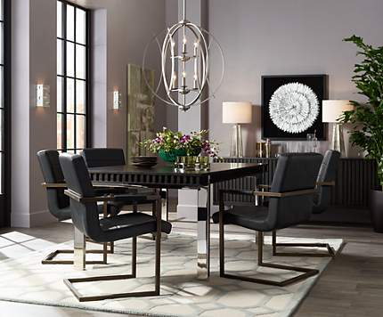 orb chandeliers lend an open and elegant look to modern dining rooms