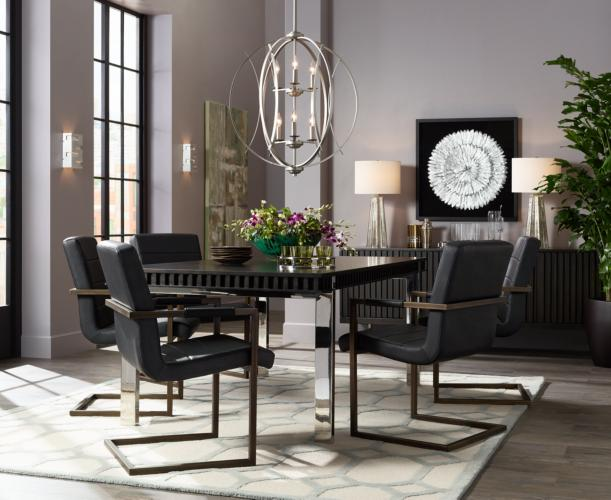 A modern dining room with an orb chandelier.