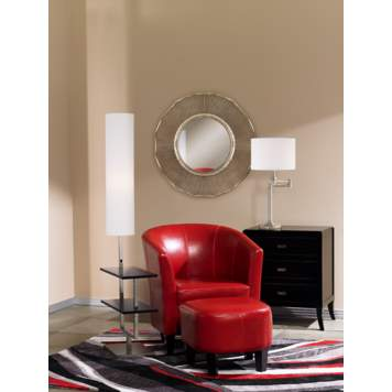 The sunrays antique silver mirror creates the focal point in the living room.