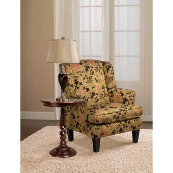 A thickly textured ivory area rug anchors a classic floral armchair.