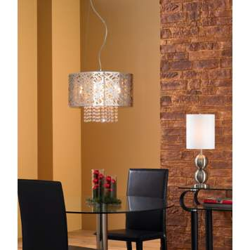 A metal and crystal chandelier is a showstopper in a modern dining room.