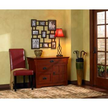 A transitional entryway - lighting, furniture styles and periods are mixed.