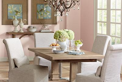 A dining room with an airy design and classic French inspired furnishings.