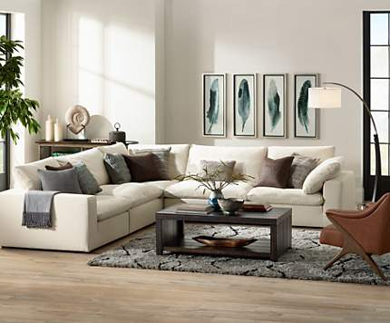 Comfy Sectional Seating Paired With A Large Arc Floor Lamp