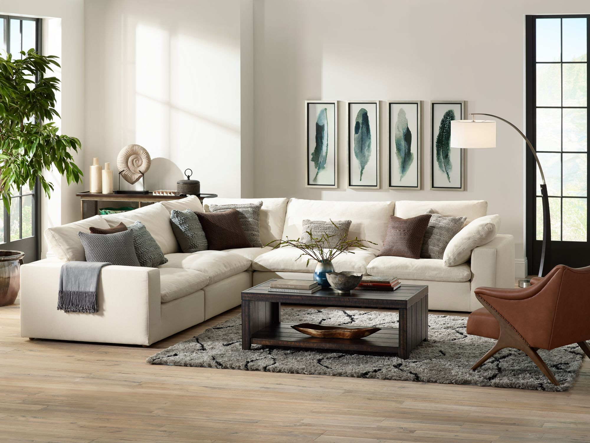 Comfy Sectional Seating Paired With A Large Arc Floor Lamp.