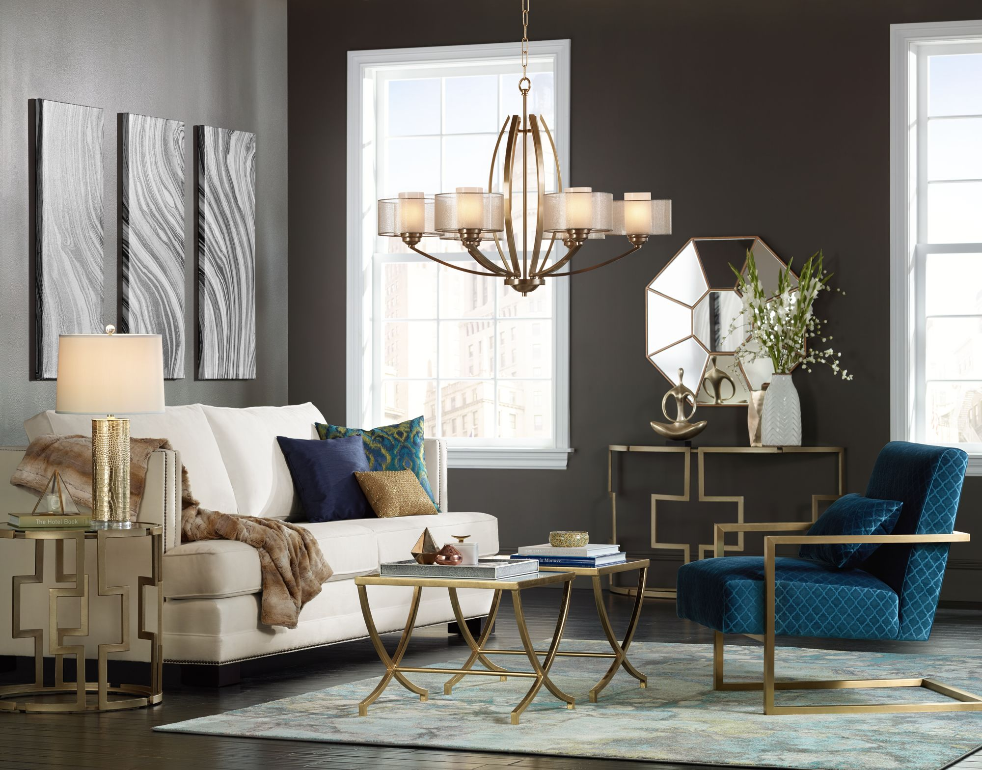 Gold Finish Lighting And Furniture Lends Sparkle To A Living Room.