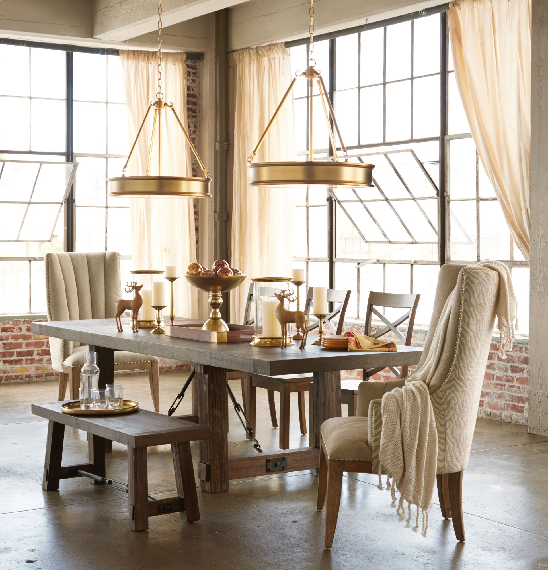 A Duo Of Pendant Lighting Is Twice As Nice In This Loft Dining Room.