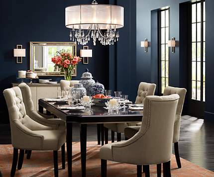 A Crystal Chandelier With Silver Silk Shade Adds Sparkle To This Dining Room