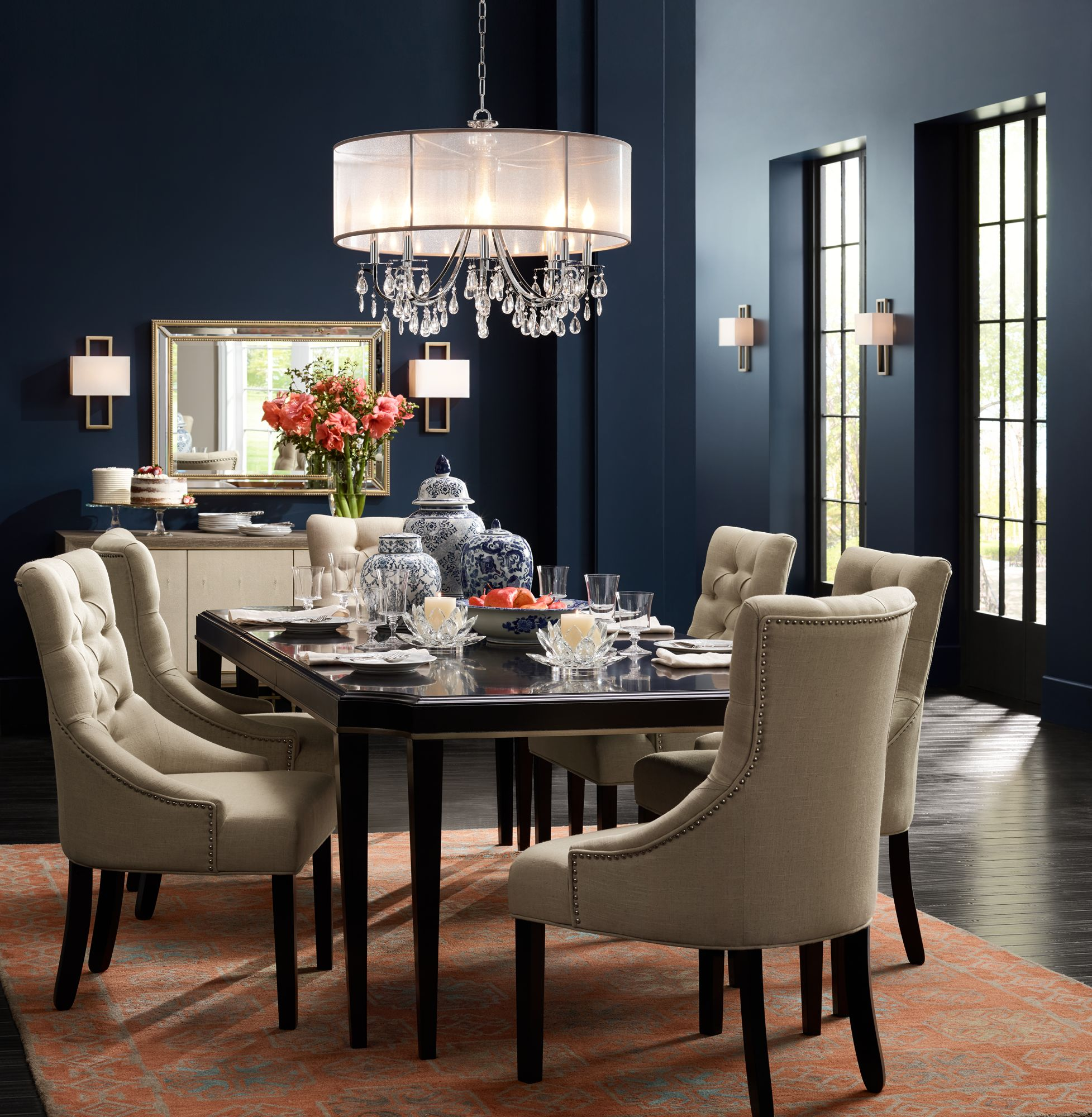 A Crystal Chandelier With A Silver Silk Shade Adds Sparkle To This Dining  Room.