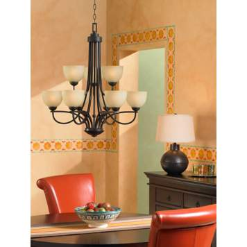 Add a table lamp near a chandelier for a beautiful dining room lighting idea.