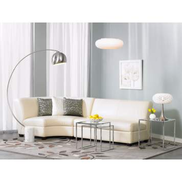 The living room furnishings combine chic and contemporary elements.
