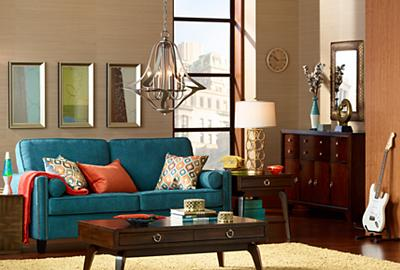 An urban city living room full of playful design elements and pops of color.