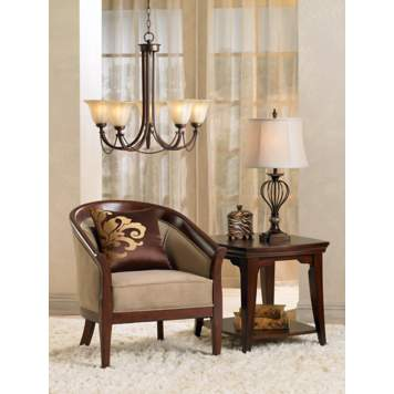 The rich wood accent chair frame ties together the coordinating end table.