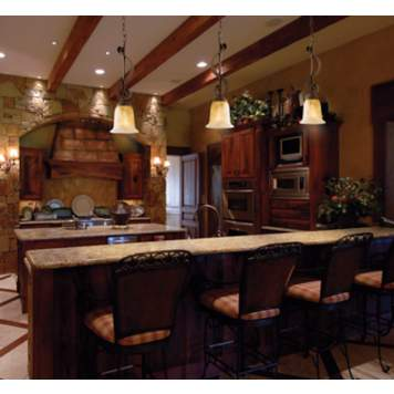 Using natural stone is a homey decorating idea in a rustic kitchen.