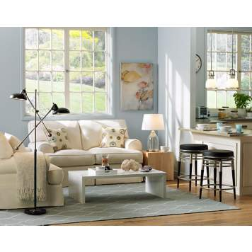 Traditional and contemporary design intersect in transitional living room decor.