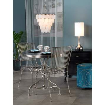 The chrome finish table and chairs set the tone for a modern space.